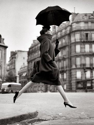 Homage to Munkacsi, Carmen, coat by Cardin, Place Francois-Premier, Paris, August 1957.