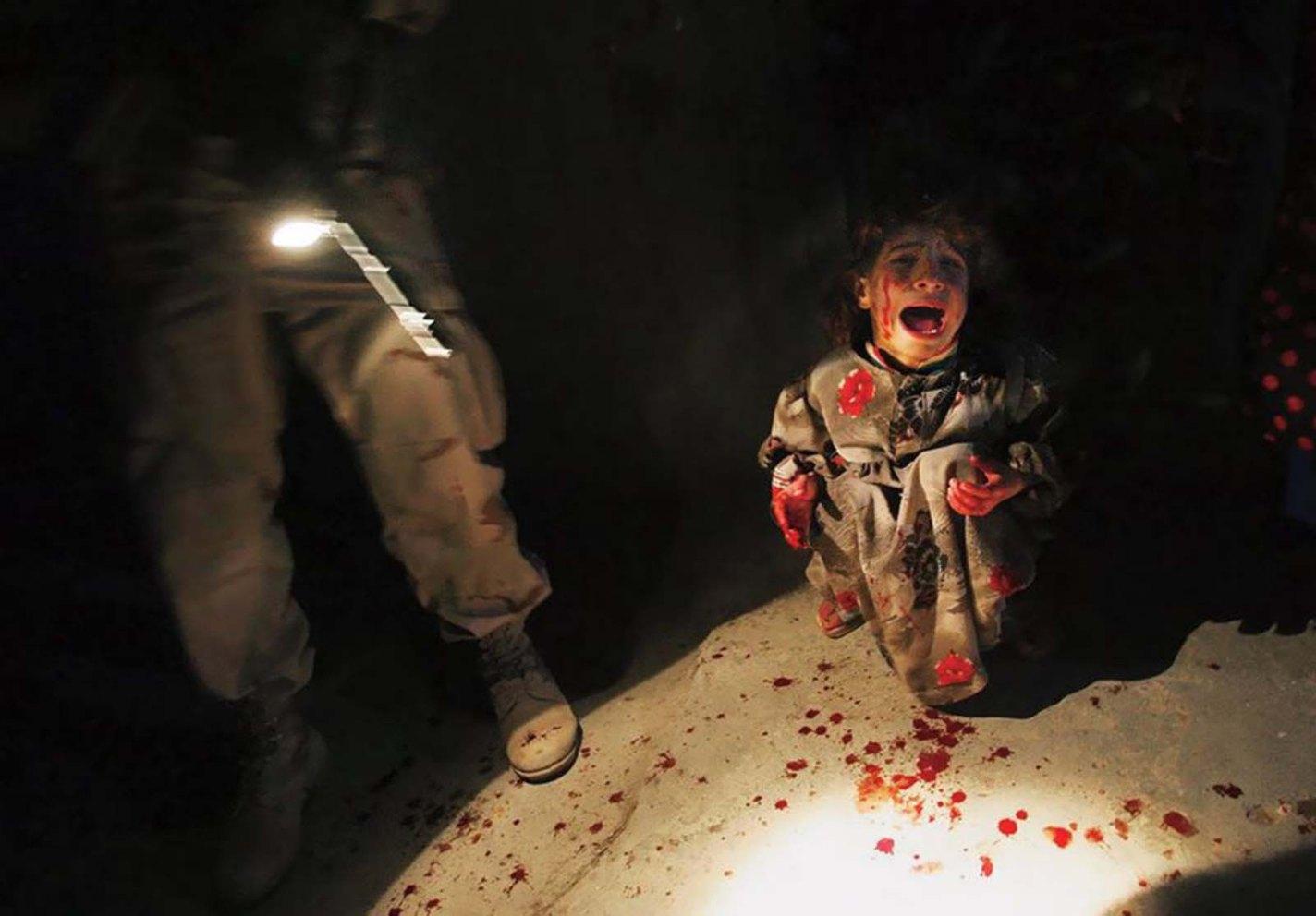 Iraqi Girl at Checkpoint, Chris Hondros, 2005