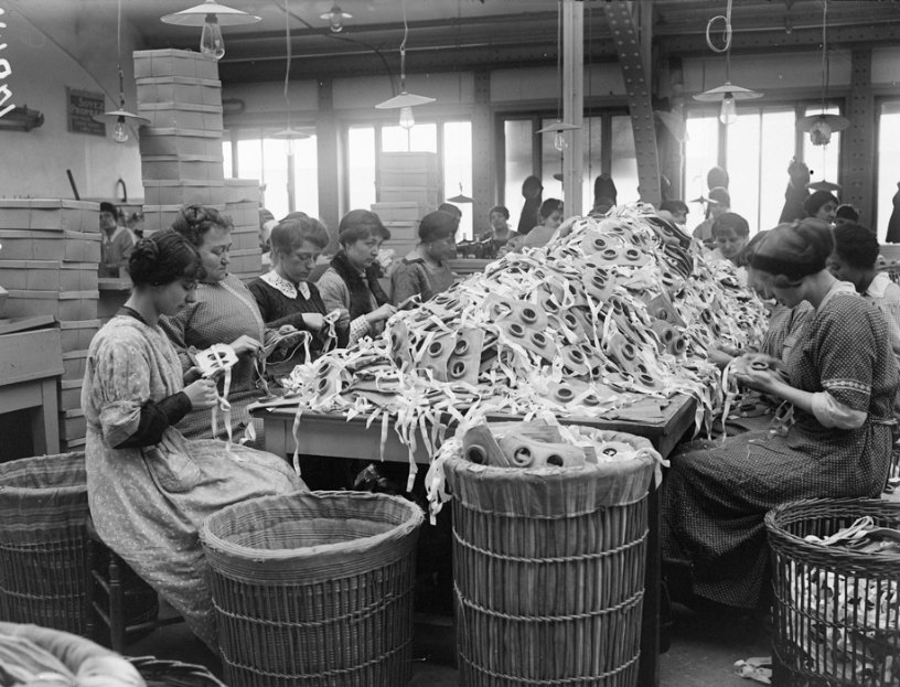 History photos of Pate-De-Vensen factory workers producing masks