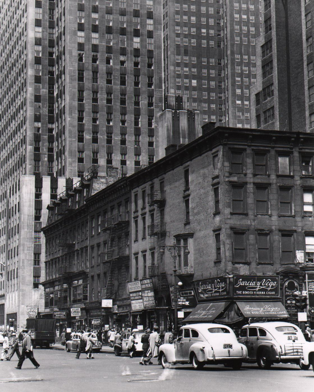 Todd Webb, Corner of 6th Avenue & 47th Street, with Rockefeller Center building in the background, 1948