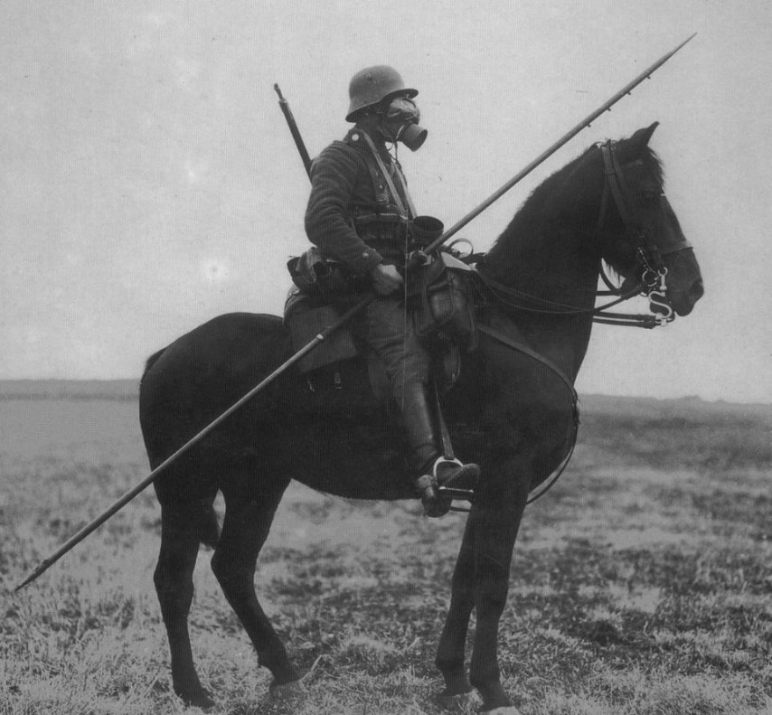 WWI German horse rider equipped with a spear and a gas mask
