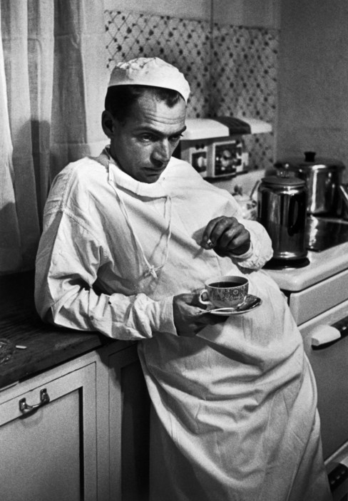 USA. Colorado. Kremmling. 1948. Dr. CERIANI resting in his kitchen, after having spent the night operating. Dr. Ernest Guy CERIANI, a country doctor (aged 32), takes care of all the people in the town of Kremmling and in the 400 miles surrounding the town. 1948.
