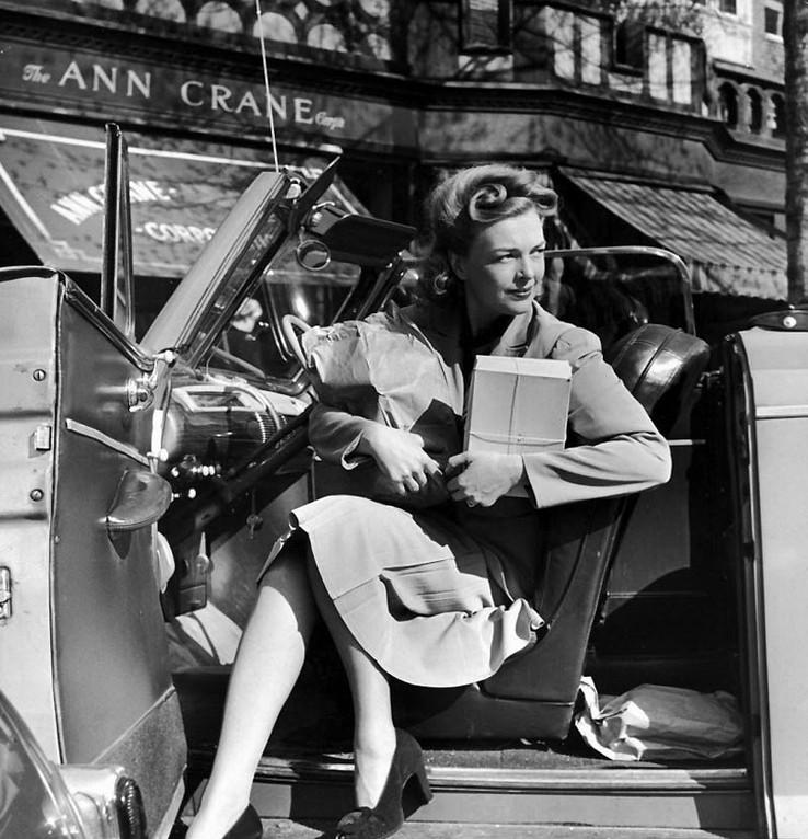 Successful women in her car, 1951