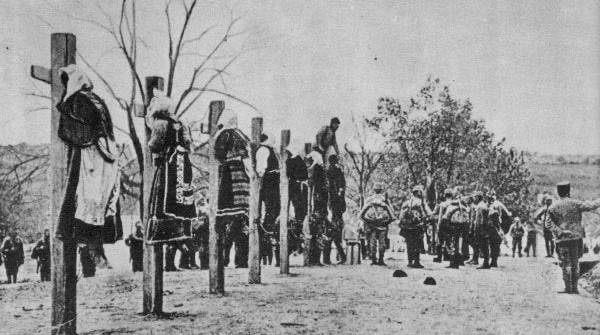 Austro-Hungarian soldiers executing men and women in Serbia, 1916.