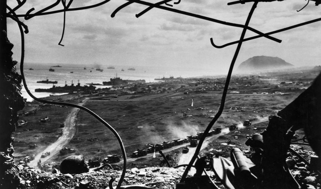 Battle of Iwo Jima. US amphibious troops seen from a former Japanese gun tower