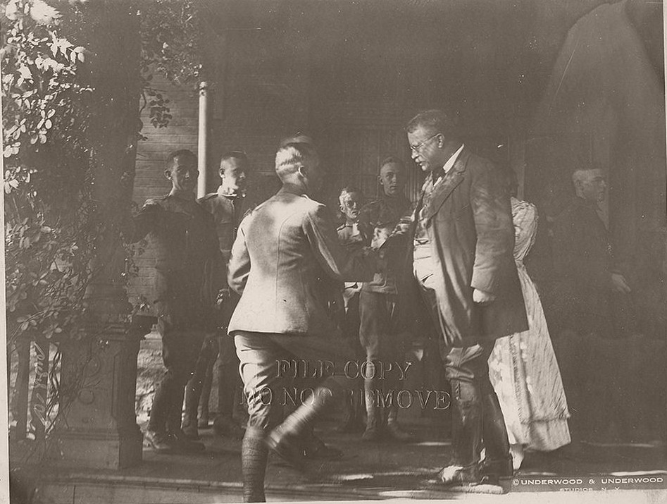 Colonel Theodore Roosevelt greeting soldiers soon deploying to France