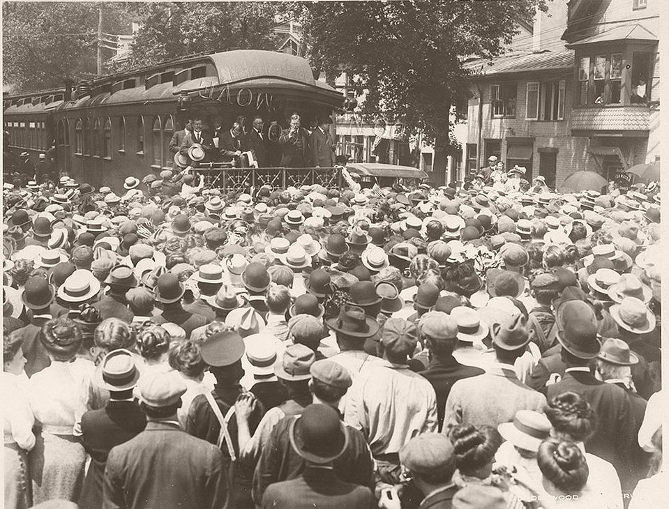 Former President Theodore Roosevelt delivering a speech from a train