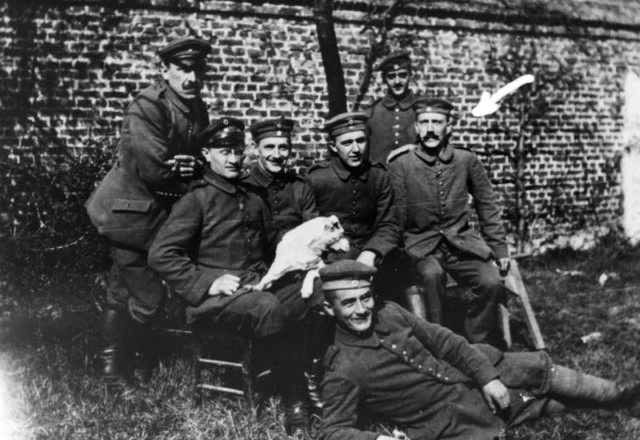 Hitler is seated on the far right of the group of WW1 comrades