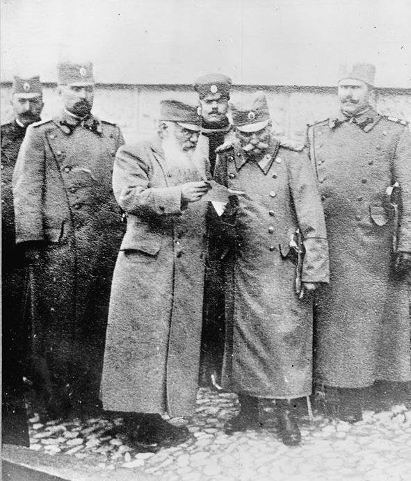 King Peter I of Serbia (centre right) in conversation with with his Prime Minister, Nikola Pašić (centre left), during WWI