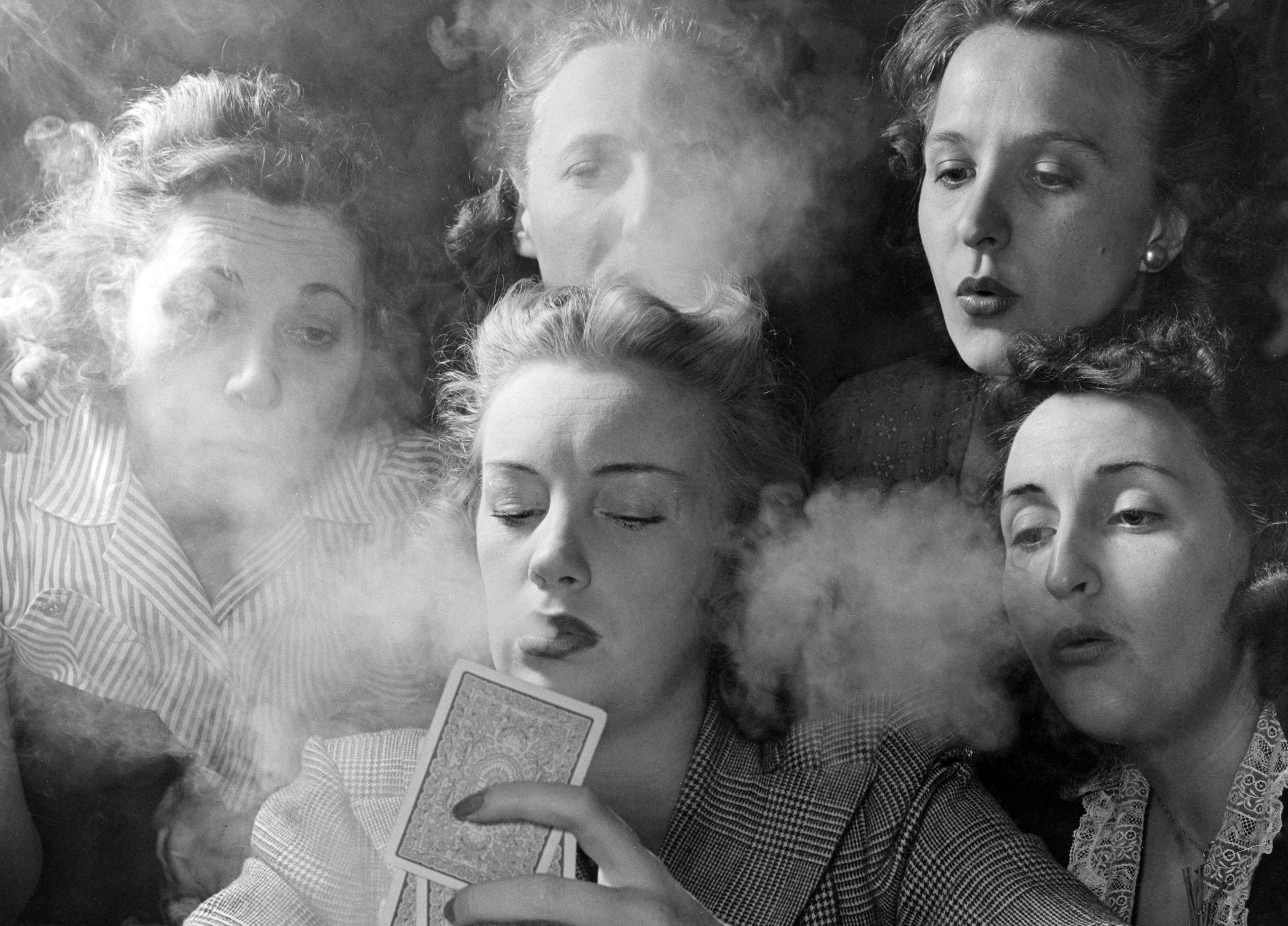 Members of the Young Women's Republican Club of Milford, Connecticut, play poker and smoke