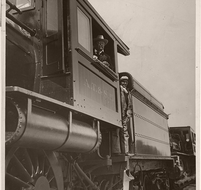 President Theodore Roosevelt posing in the cab of his locomotive, while campaigning for re-election