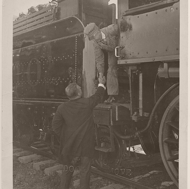 President Theodore Roosevelt shaking hands with a locomotive engineer for the Colorado and Southern Railway