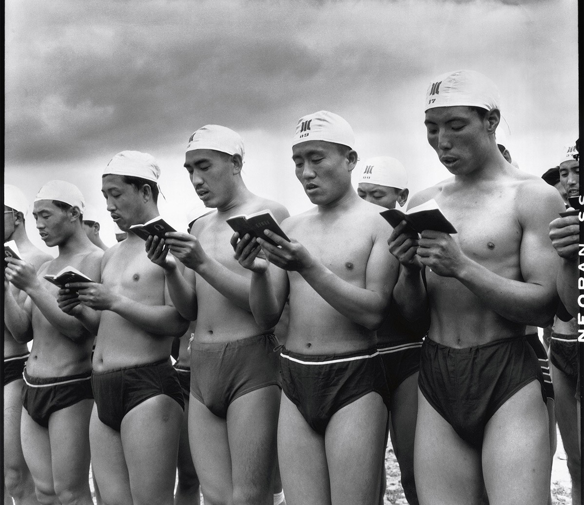 Swimmers reading the Mao Quotes