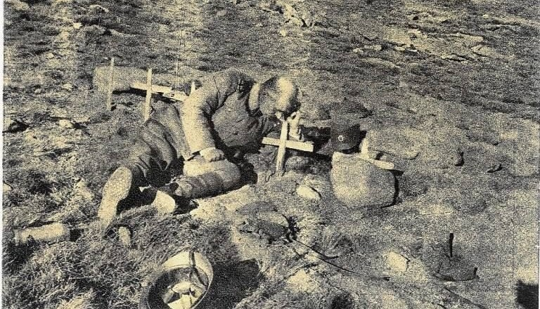 Serbian soldier on his only son's grave (also soldier), WW1. Serbia lost 25% of population (1 million killed_died), including 60% of adult male population in a war