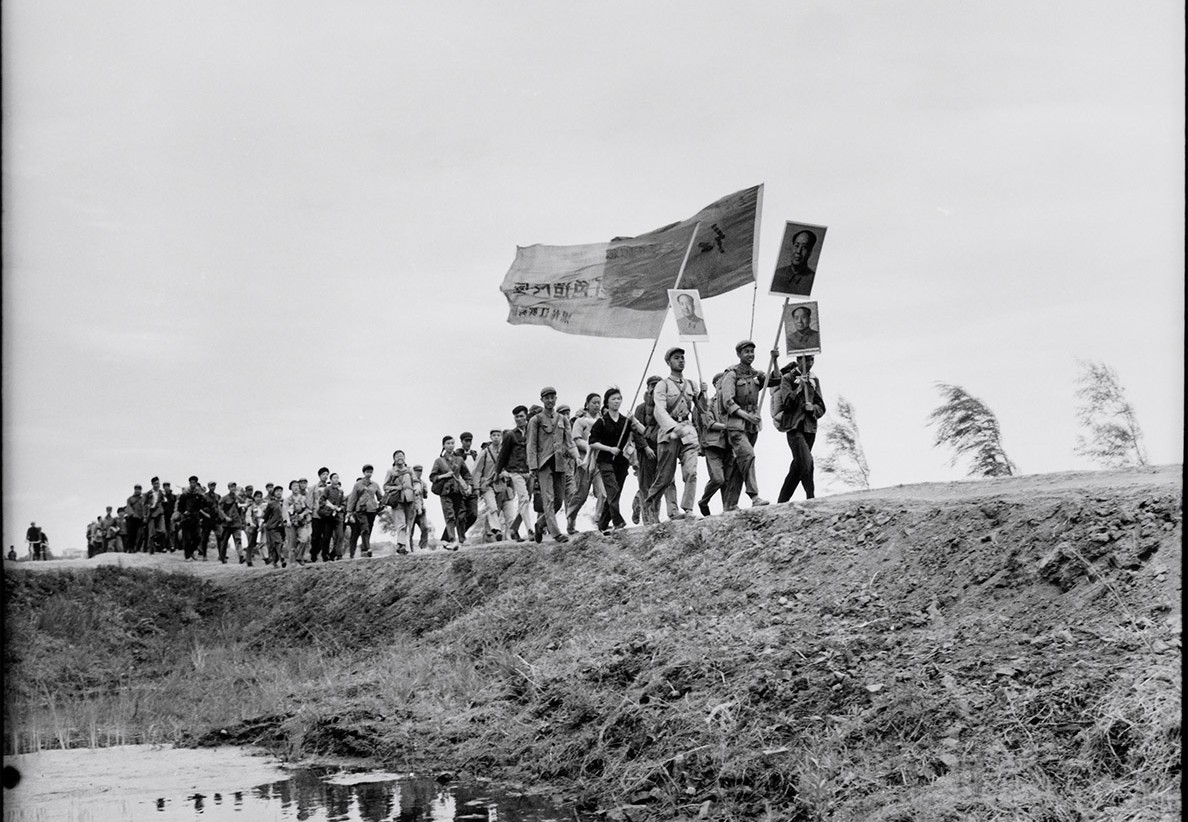 Red Guards marching while singing a song about The Great Helmsman