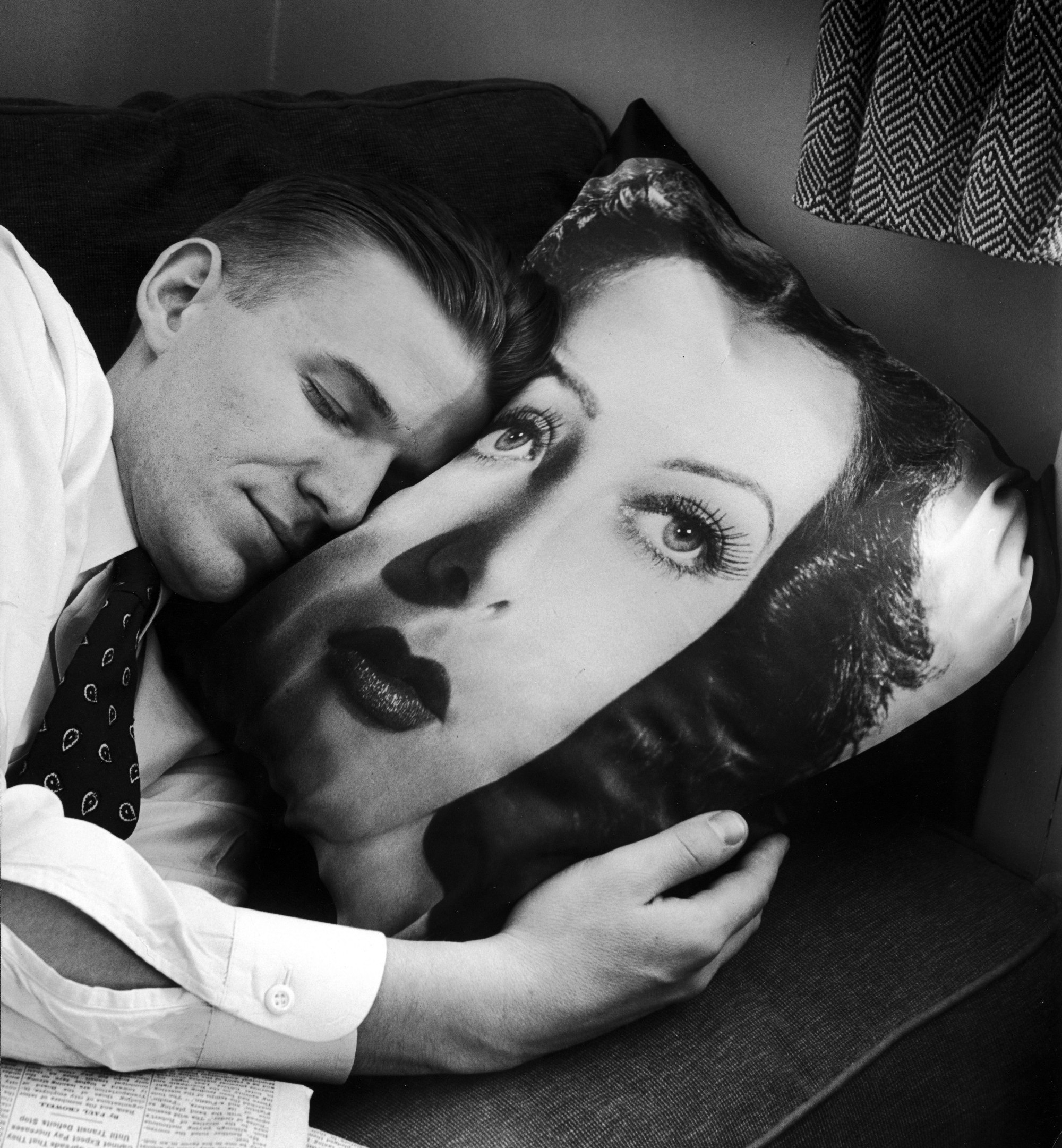 Sleeping man with Hedy Lamarr pillow, 1947.