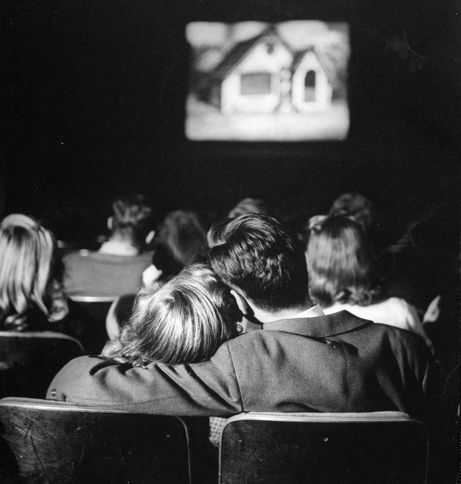 Teenage couple at the movies, 1944.