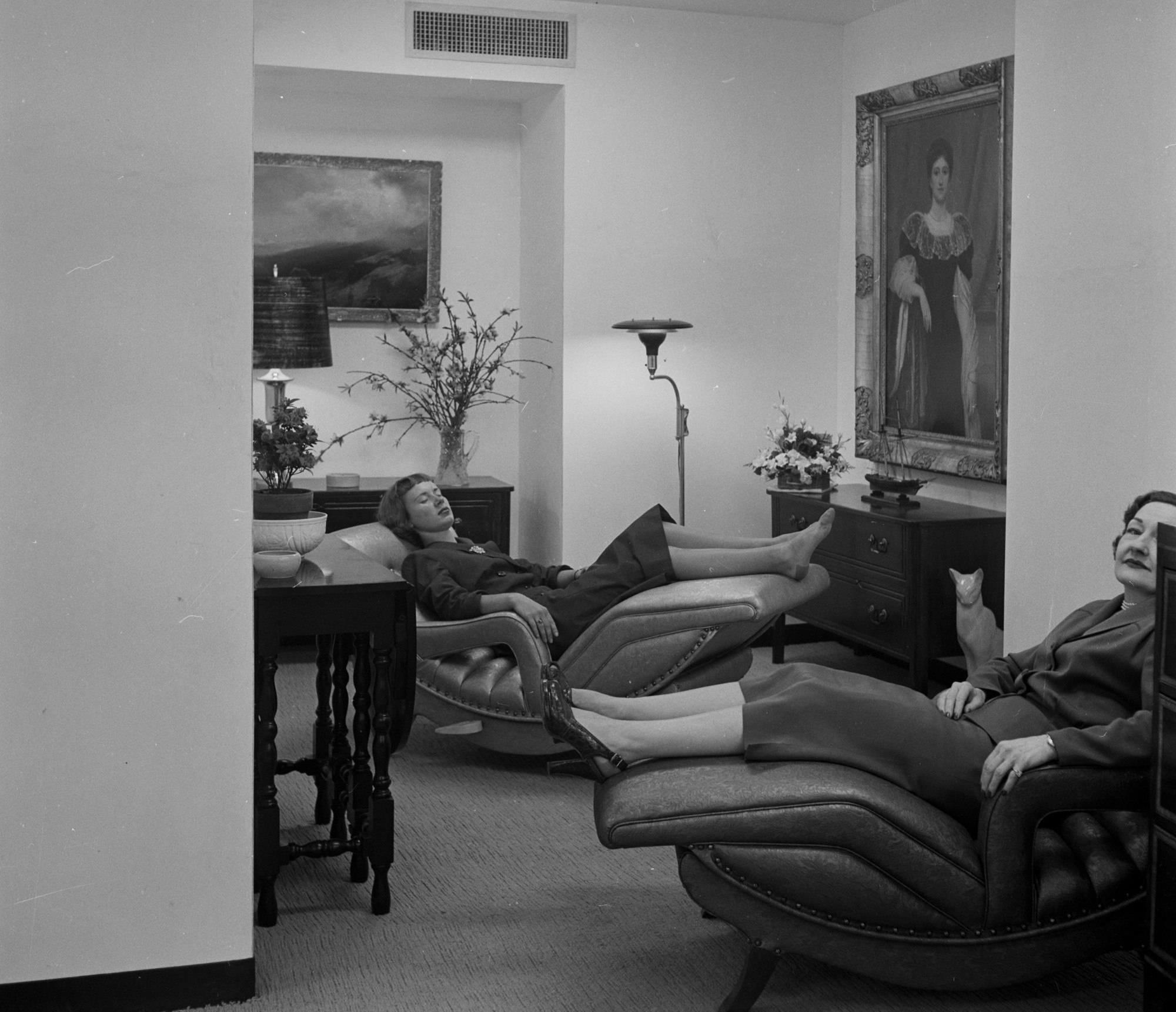 Two members of the Pamper Club—a Manhattan salon and social club catering to working girls and suburban housewives—resting on contour chairs in 1952.