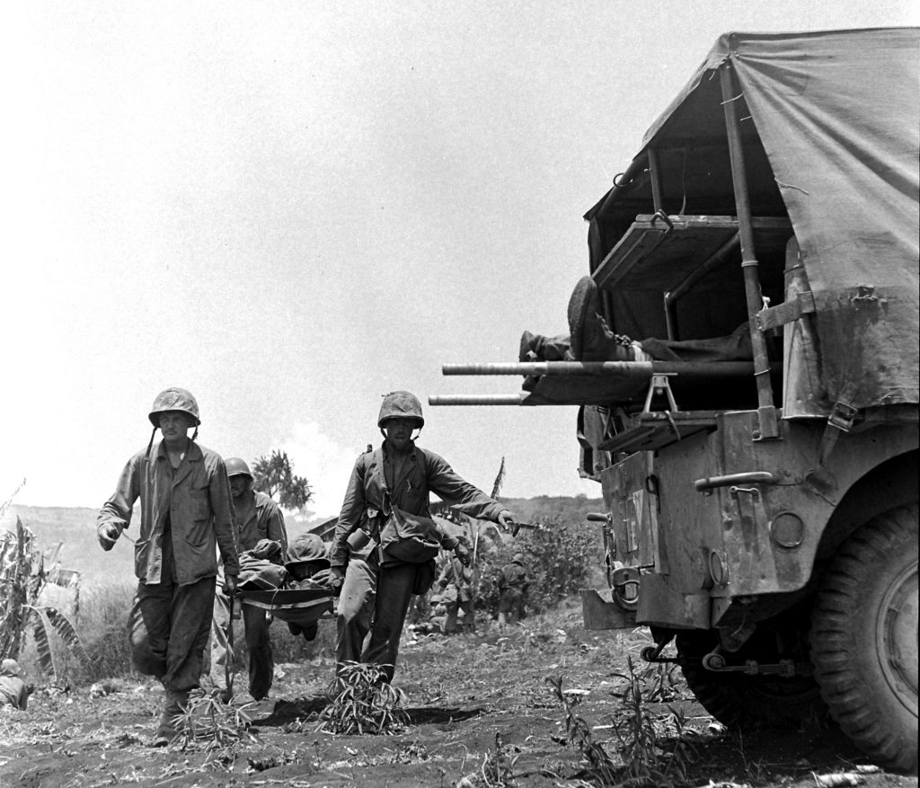 U.S. Marines tended to wounded comrades while the fighting raged on during the battle to take Saipan.
