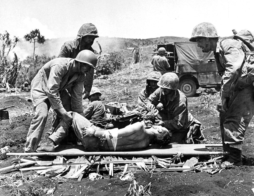 U.S. soldiers tended to wounded comrades while the fighting raged on during the battle to take Saipan.