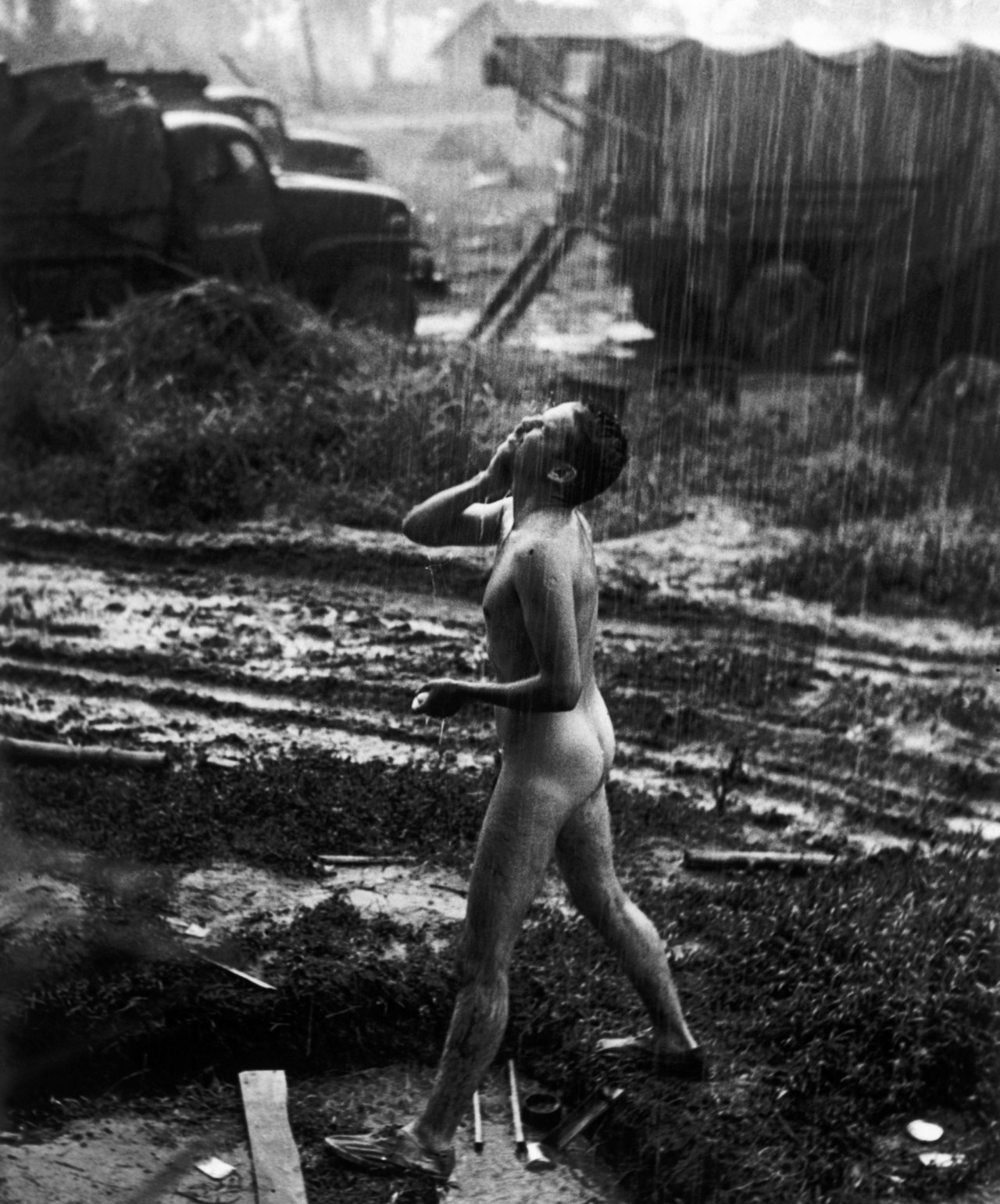 US soldier washing in the rain
