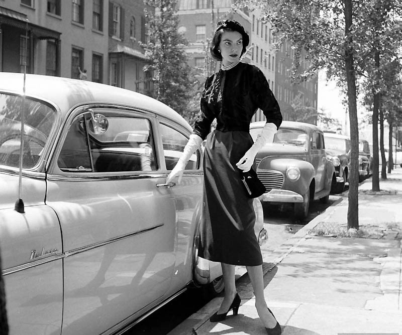 Woman opening a car, 1952