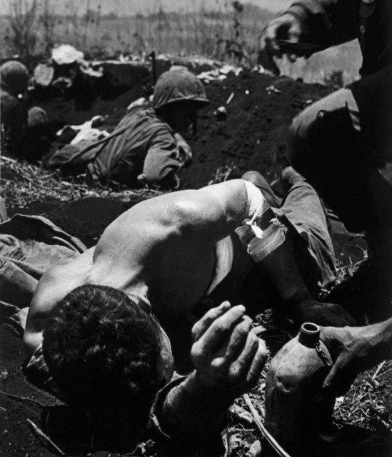 Wounded US marines during the Battle of Saipan Island
