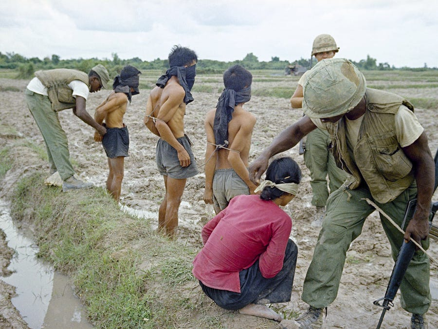 A battalion scoured Trung Jap, northwest of Saigon, for information on a Vietcong force in the area. A Vietcong bride was arrested, blindfolded and bound, when troopers saw her hiding a bag.