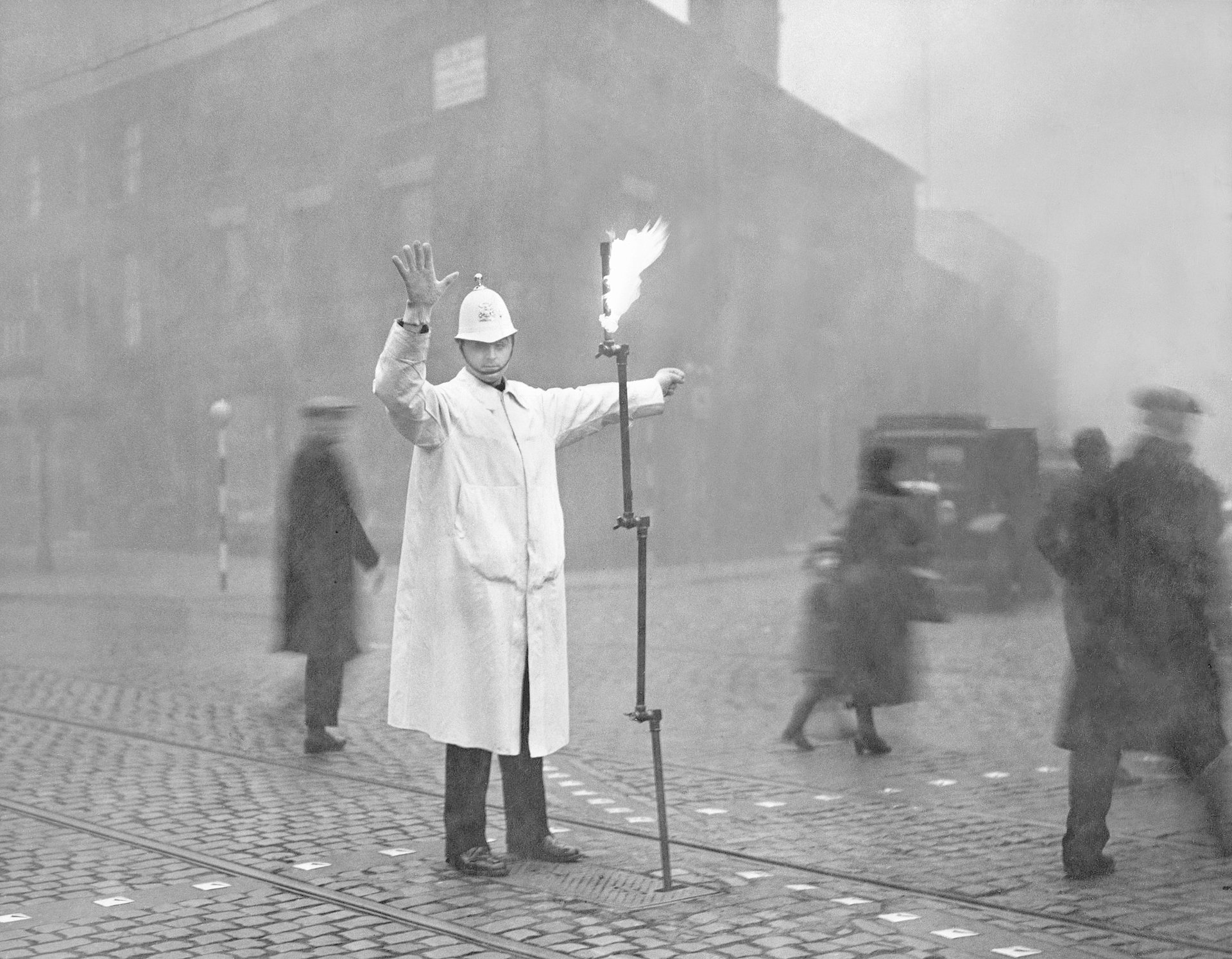 A street traffic police with a torch