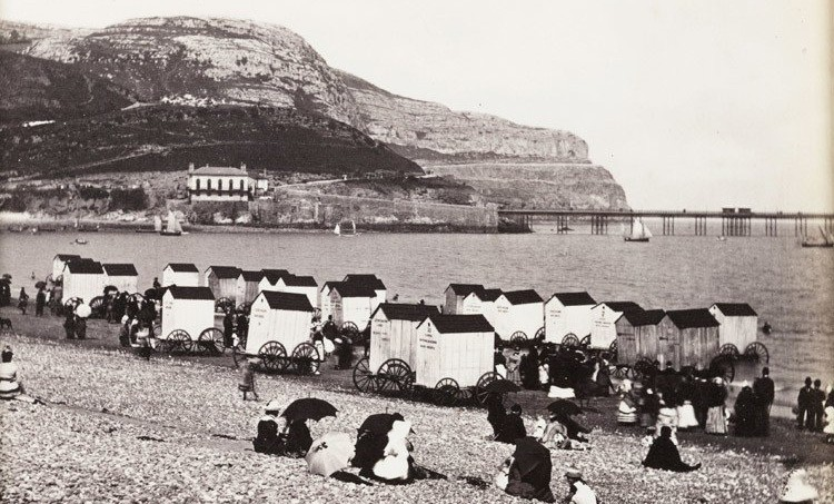 Bathing machines crowd the beach at Llandudno on the north coast of Wales. Photo- SSPL_Getty Images
