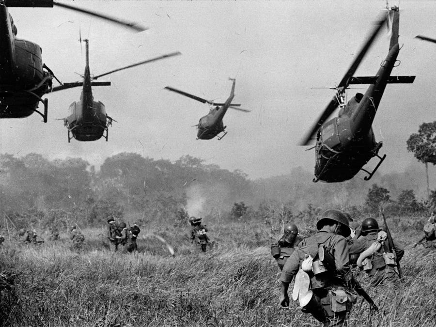 In this March 1965 photo, U.S. Army helicopters provide artillery cover to advancing South Vietnamese ground troops in an attack on a Viet Cong camp 18 miles north of Tay Ninh, near the Cambodian border.
