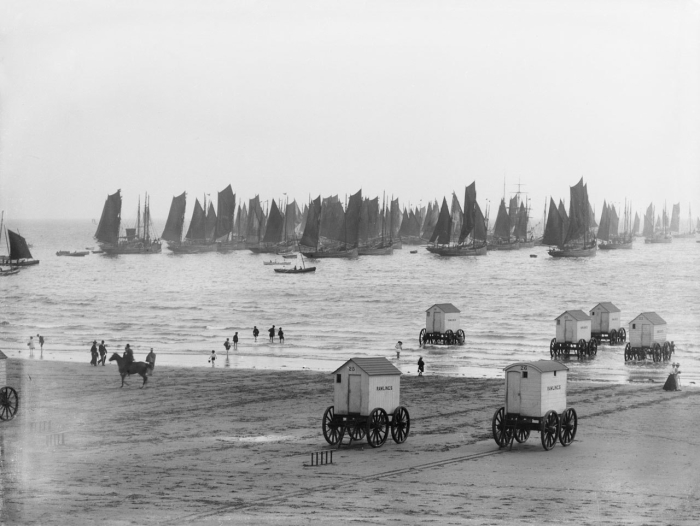 Bathing machines are going into the sea