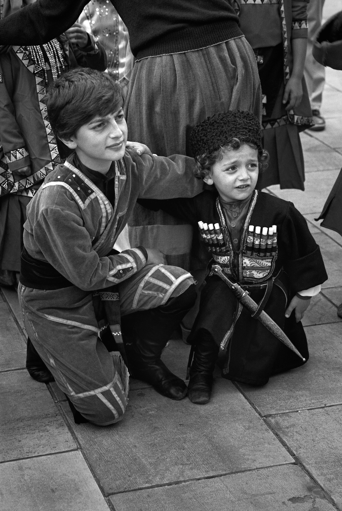Kids in their national suits. They belong to some southern nationalities of the USSR