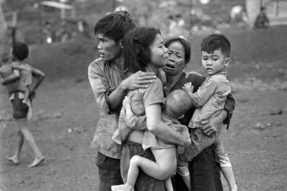 Survivors of two days of heavy fighting in Dong Huo, civilians gather after an attack by government forces, June 1965