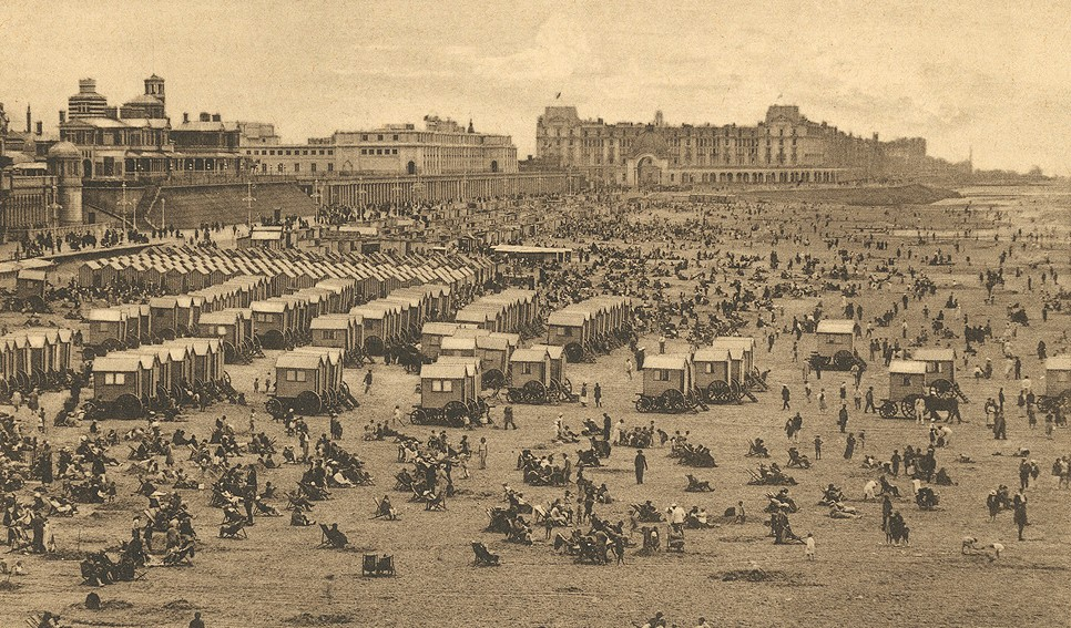 The beach crowded with Bathing machines