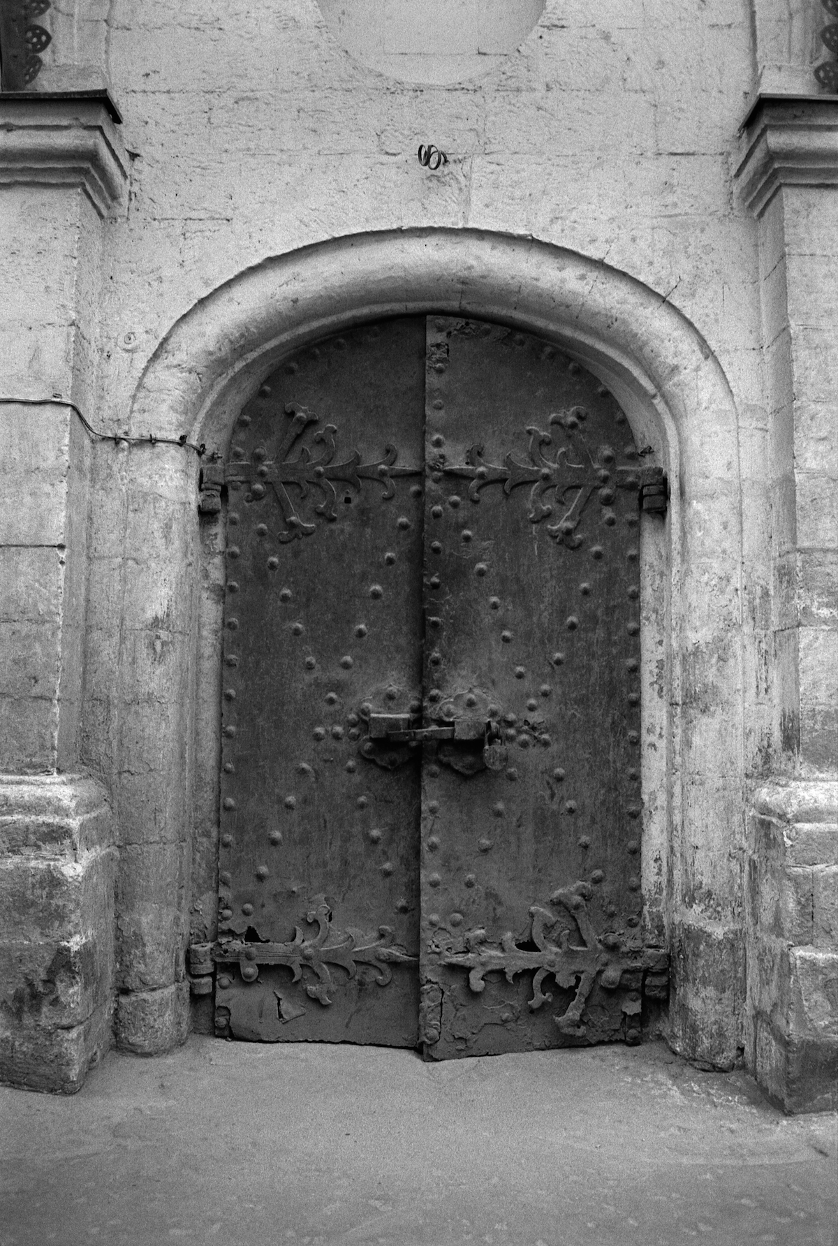 The doors of the ancient monastery. Religious buildings were in a poor state as USSR didn't tolerate the religion in any way.