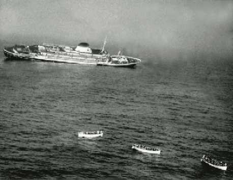 The luxury Italian liner Andrea Doria, listing heavily starboard in the final moments of her death throes, 1956.