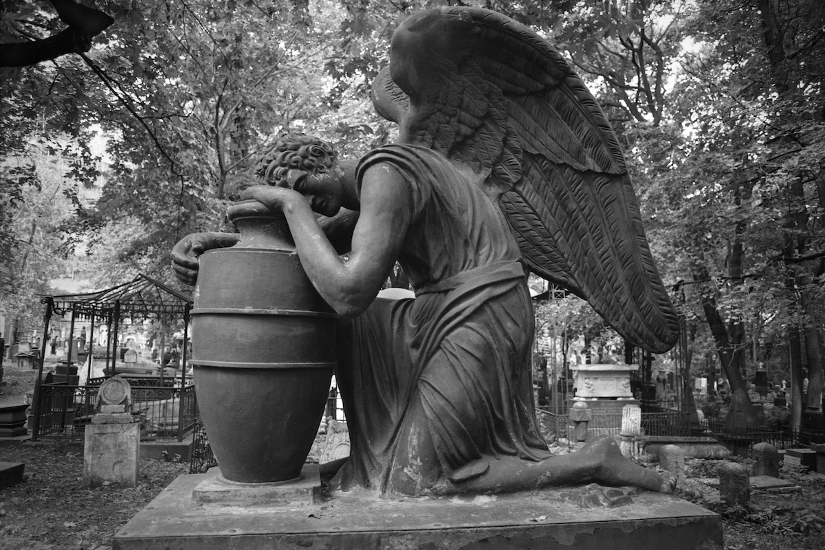 This sculpture was located at one of the Moscow cemeteries.