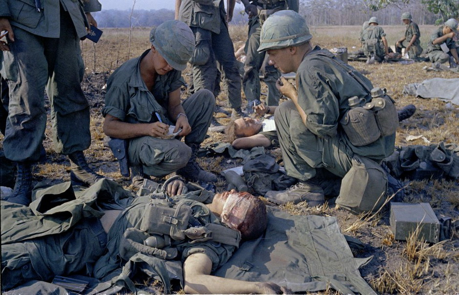 Horst Faas photo of a Wounded American soldiers on a battlefield in Vietnam on April 2, 1967.