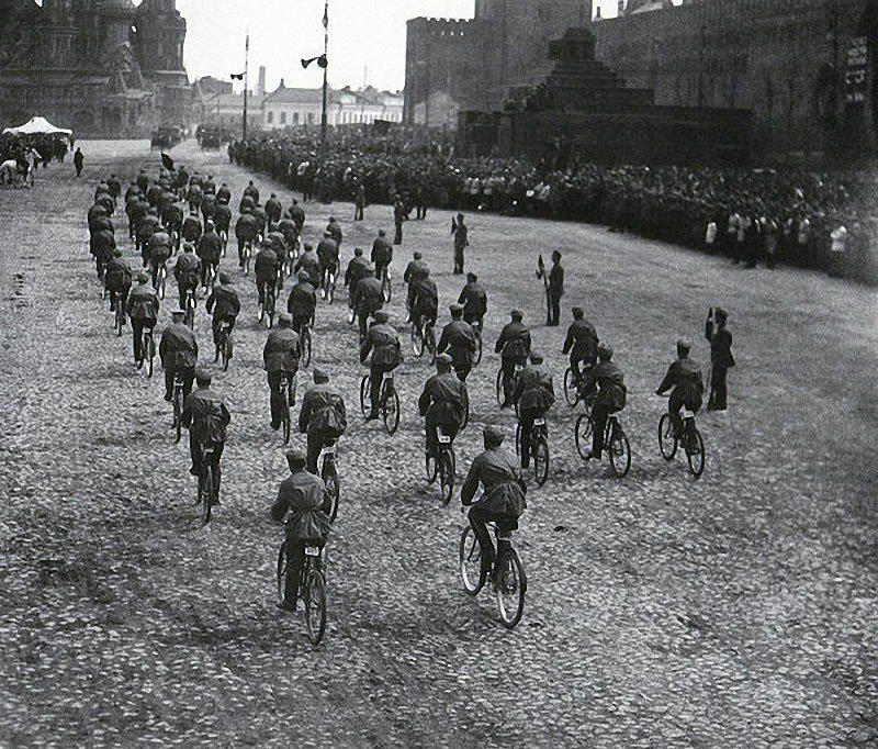Bicycle riders during an army parade in Soviet Union