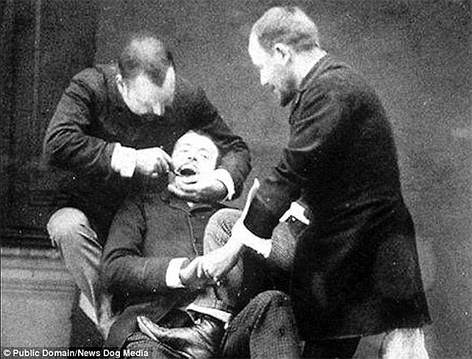 1892 The assistant holds the patient firmly so that he does not twitch or interfere.