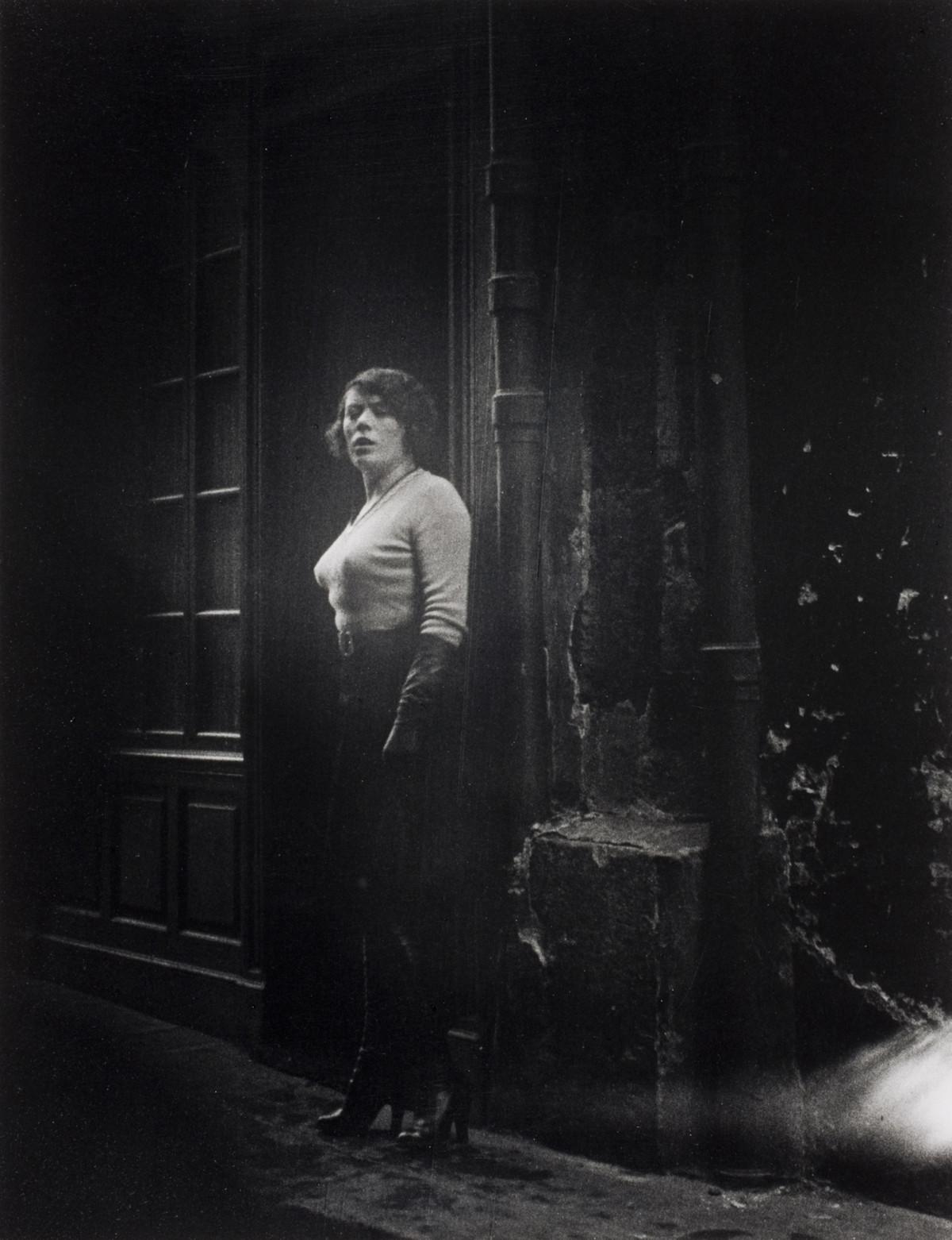 A prostitute on the rue Saint-Denis in Paris, 1932.