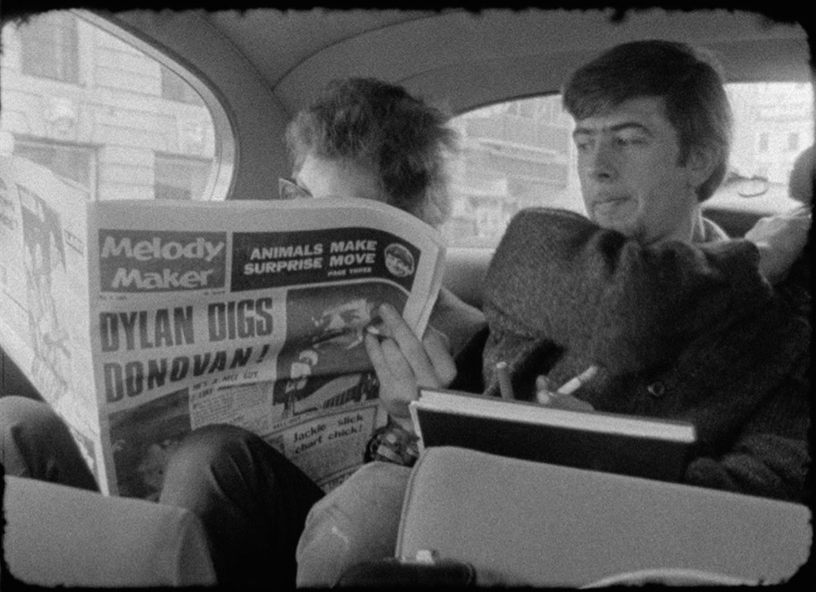 Bob Dylan reading Melody Maker with John Mayall looking on London 1966