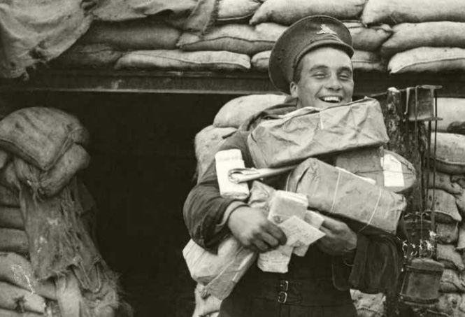 British soldier is going to the no-man land to exchange the Christmas gifts