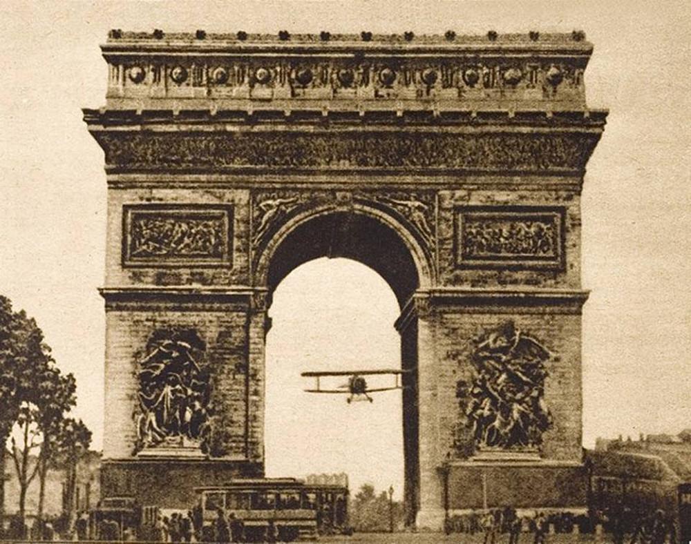 Charles Godefroy flies through the Arc de Triomphe in Paris.