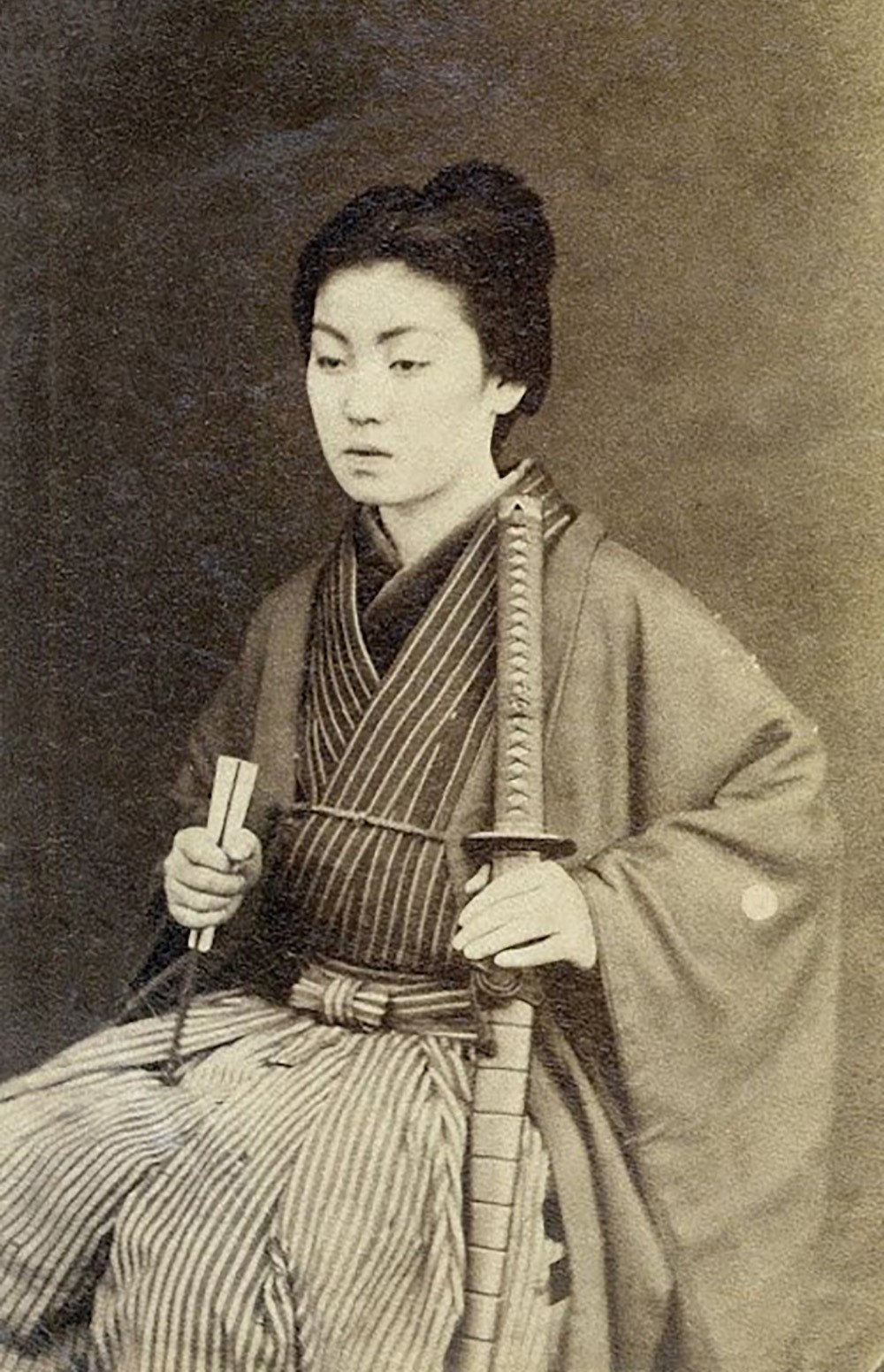 Female samurai with a traditional sword