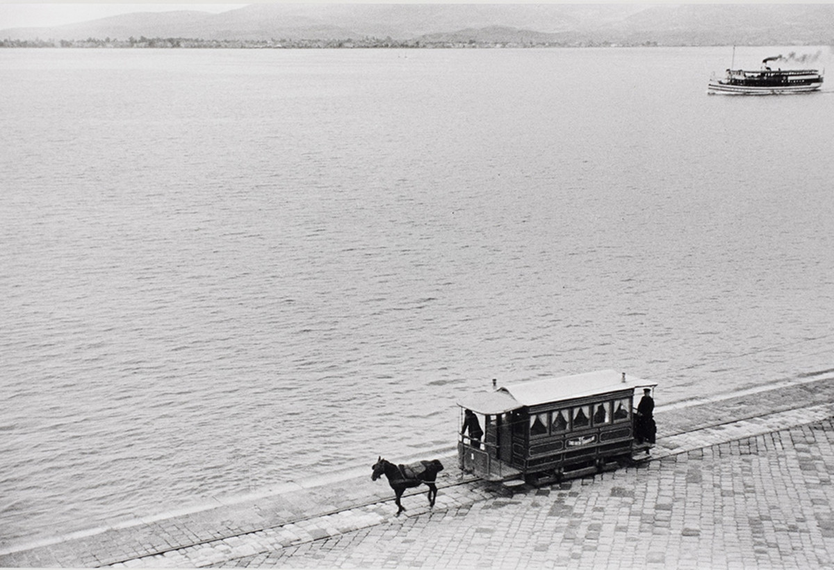 Horse tram and steamer in the harbor of Izmir, Turkey, 1934.