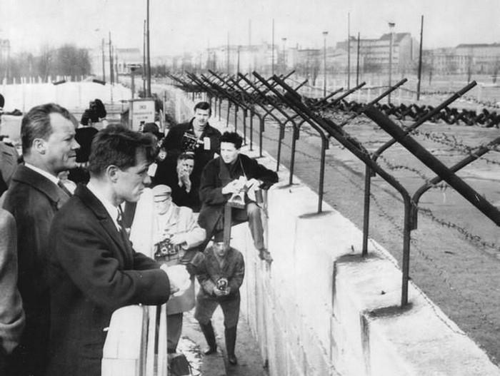 Robert Kennedy and West Berlin Mayor Willie Brandt look through the Berlin Wall, February 22, 1962