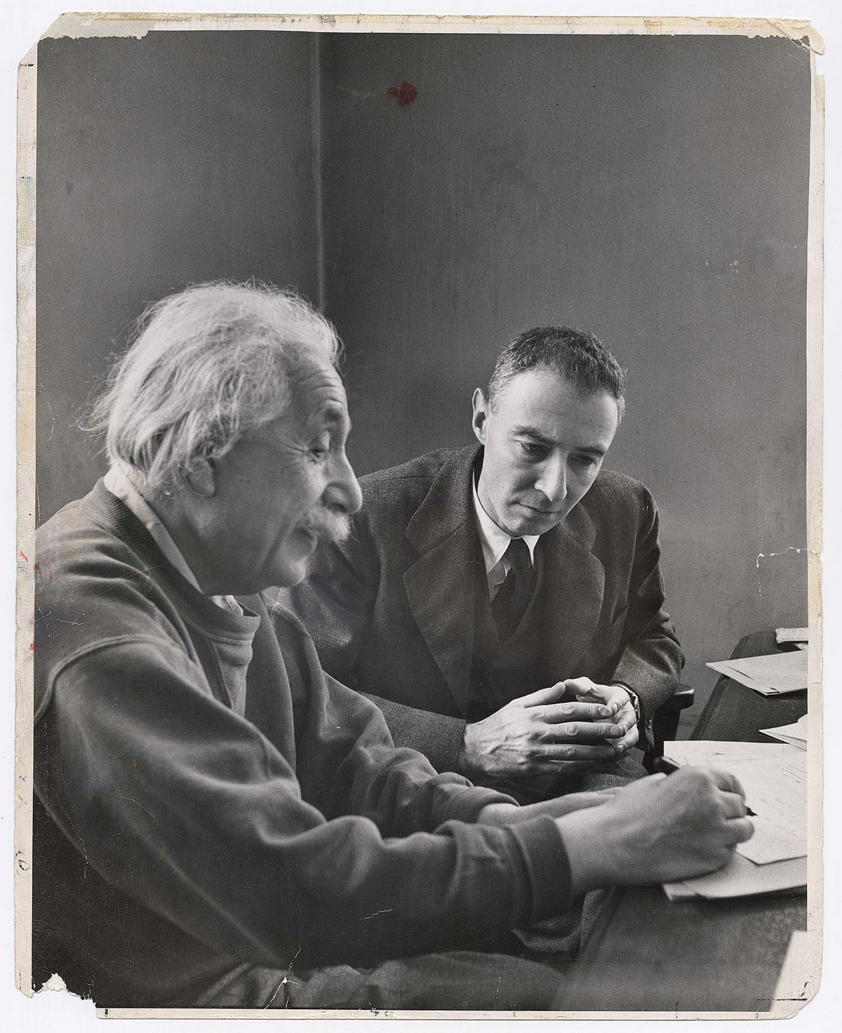 Alfred Eisenstaedt photos of  Robert Oppenheimer, Director of the Institute for Advanced Study, discusses the theory of matter in terms of space with Albert Einstein in Princeton, New Jersey, 1947.