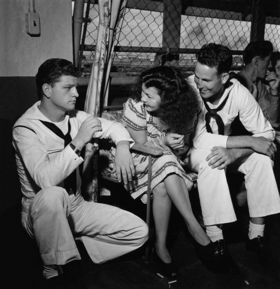 Pictures of Sailors with a local girl
